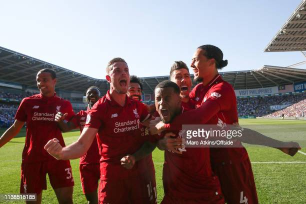 Georginio Wijnaldum of Liverpool celebrates scoring their 1st goal with team mates during the Premier League match between Cardiff City and Liverpool...