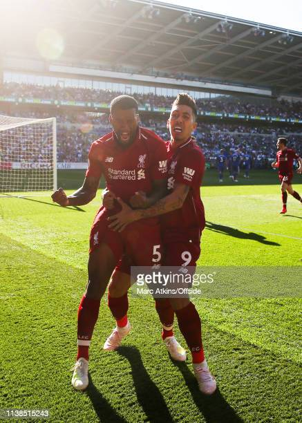 Georginio Wijnaldum of Liverpool celebrates scoring their 1st goal with Roberto Firmino during the Premier League match between Cardiff City and...