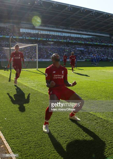Georginio Wijnaldum of Liverpool celebrates scoring their first goal during the Premier League match between Cardiff City and Liverpool FC at Cardiff...