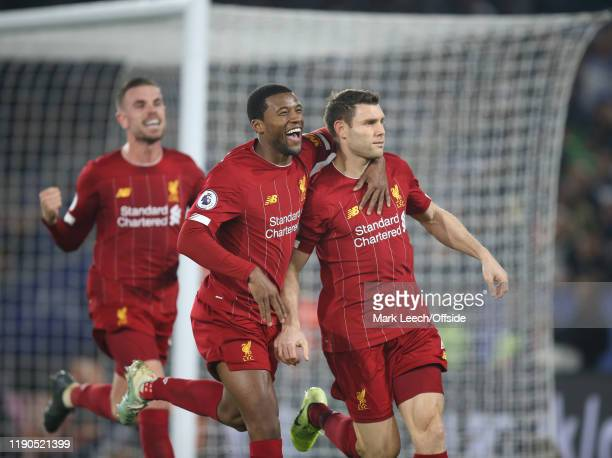 Georginio Wijnaldum of Liverpool celebrates the second goal scored by James Milner of Liverpool during the Premier League match between Leicester...