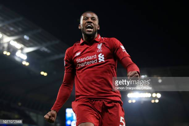Georginio Wijnaldum of Liverpool celebrates their 1st goal during the Premier League match between Manchester City and Liverpool at the Etihad...