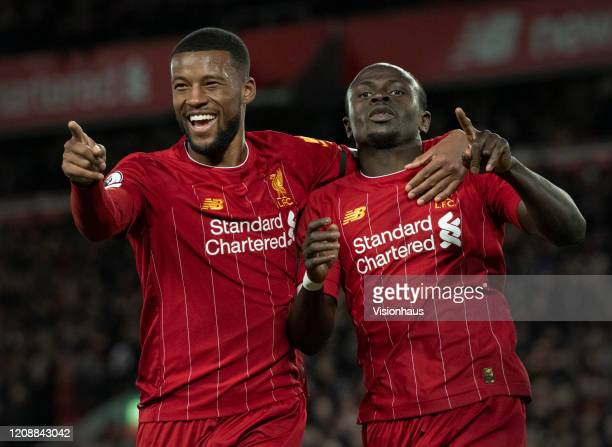 Georginio Wijnaldum of Liverpool celebrates with goalscorer Sadio Mane before the goal is disallowed by VAR during the Premier League match between...