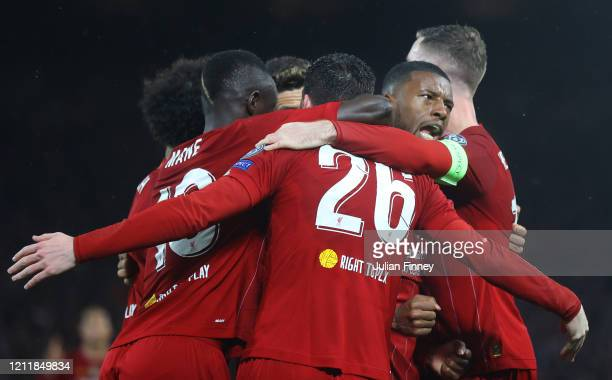 Georginio Wijnaldum of Liverpool celebrates with his team mates after scoring his team's first goal during the UEFA Champions League round of 16...