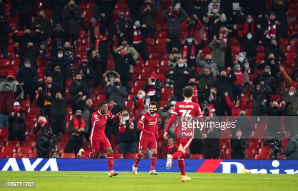 Georginio Wijnaldum of Liverpool celebrates with team mates Mohamed Salah snd Neco Williams after scoring their sides second goal during the Premier...