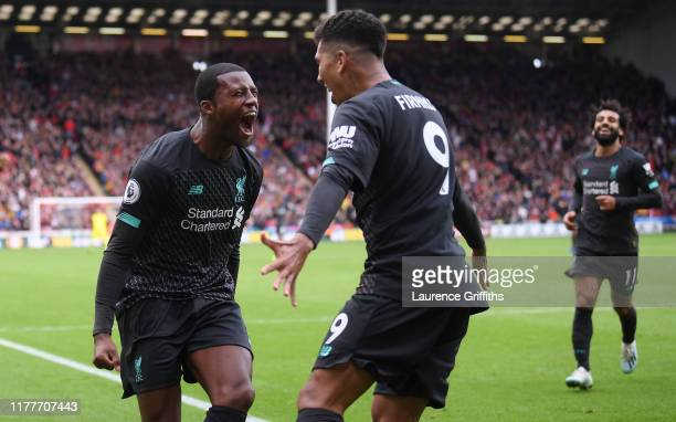 Georginio Wijnaldum of Liverpool celebrates with teammate after scoring his team's first goal during the Premier League match between Sheffield...