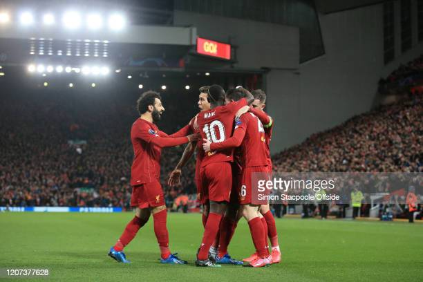 Georginio Wijnaldum of Liverpool celebrates with teammates Mohamed Salah of Liverpool and Roberto Firmino of Liverpool after scoring their 1st goal...