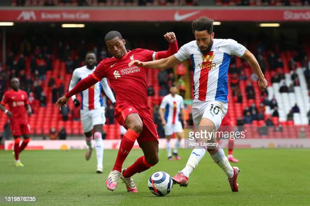 Georginio Wijnaldum of Liverpool challenges Andros Townsend of Crystal Palace during the Premier League match between Liverpool and Crystal Palace at...