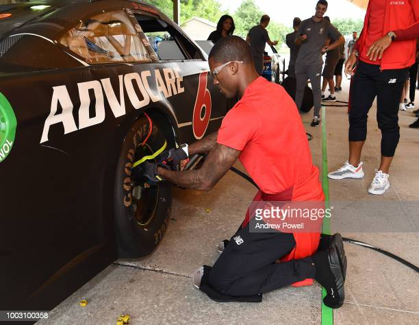 Georginio Wijnaldum of Liverpool changing tyres during a tour of Roush Fenway Racing on July 21 2018 in Charlotte North Carolina