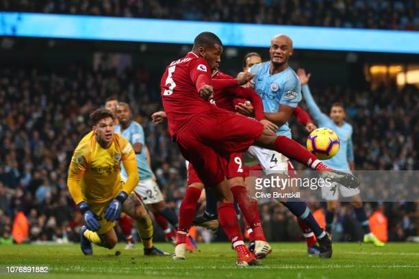 Georginio Wijnaldum of Liverpool clears the ball during the Premier League match between Manchester City and Liverpool FC at the Etihad Stadium on...
