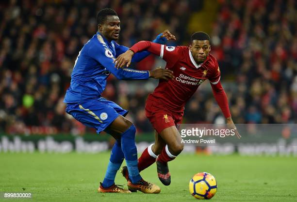 Georginio Wijnaldum of Liverpool competes with Daniel Amartey of Leicester City during the Premier League match between Liverpool and Leicester City...