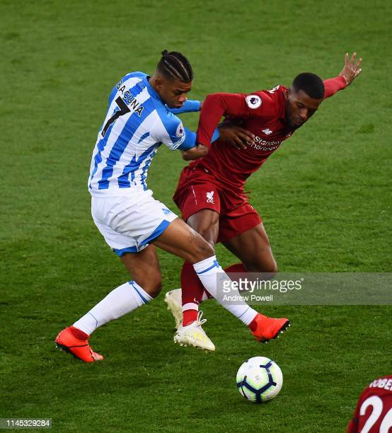 Georginio Wijnaldum of Liverpool competes with Juninho Bacuna of Huddersfield Town during the Premier League match between Liverpool FC and...