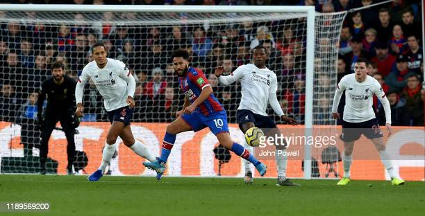 Georginio Wijnaldum of Liverpool competing with Andros Townsend of Crystal Palace during the Premier League match between Crystal Palace and...