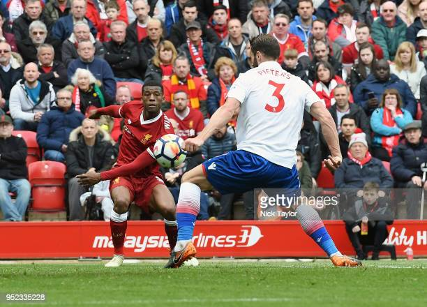 Georginio Wijnaldum of Liverpool crosses the ball in the box but Erik Pieters of Stoke City handles it during the Premier League match between...