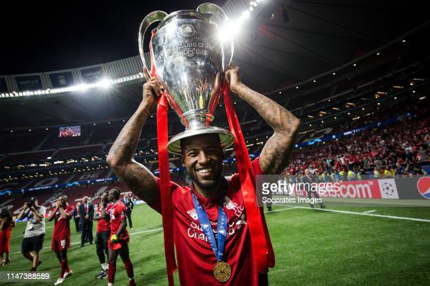 Georginio Wijnaldum of Liverpool FC, celebrates the victory with the trophy during the UEFA Champions League match between Tottenham Hotspur v...