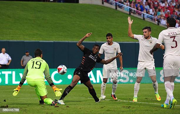 Georginio Wijnaldum of Liverpool FC shoots as Becker Alisson of AS Roma defends during a friendly match at Busch Stadium on August 1 2016 in St Louis...