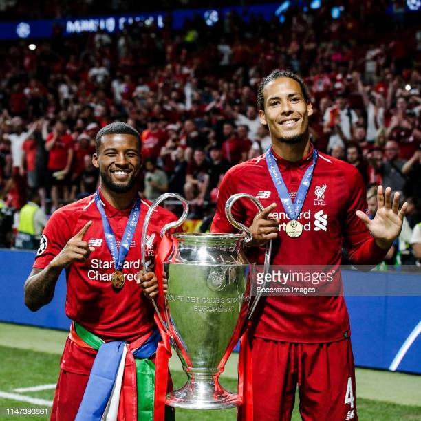 Georginio Wijnaldum of Liverpool FC, Virgil van Dijk of Liverpool FC, celebrates the victory with the trophy during the UEFA Champions League match...