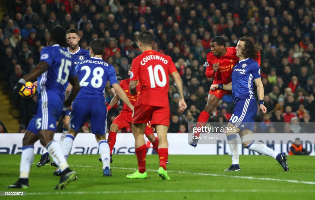 Georginio Wijnaldum (2nd R) of Liverpool heads to score his side's first goal to make it 1-1 during the Premier League match between Liverpool and Chelsea at Anfield on January 31, 2017 in Liverpool, England.