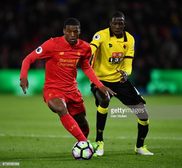 Georginio Wijnaldum of Liverpool holds off Abdoulaye Doucoure of Watford during the Premier League match between Watford and Liverpool at Vicarage...