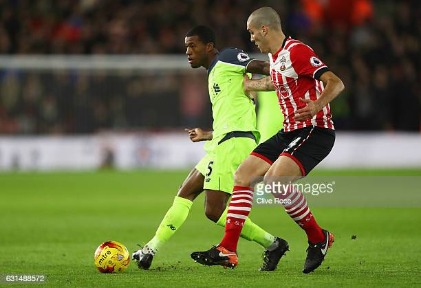 Georginio Wijnaldum of Liverpool holds off Oriol Romeu of Southampton during the EFL Cup semifinal first leg match between Southampton and Liverpool...