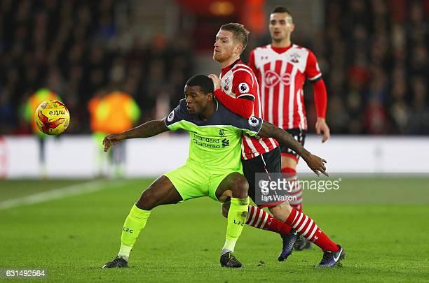 Georginio Wijnaldum of Liverpool holds off Steven Davis of Southampton during the EFL Cup semifinal first leg match between Southampton and Liverpool...