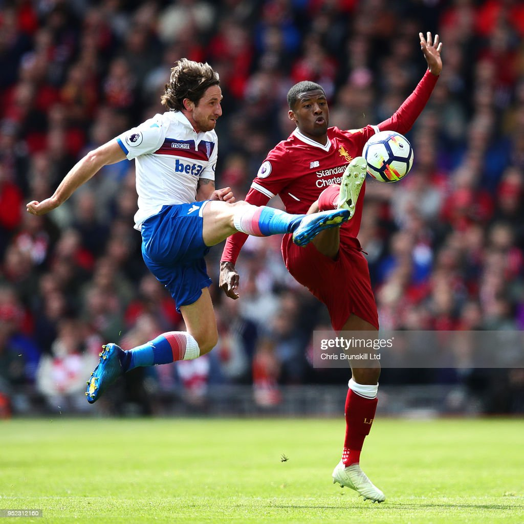 Georginio Wijnaldum of Liverpool in action with Joe Allen of Stoke City during the Premier League match between Liverpool and Stoke City at Anfield on April 28, 2018 in Liverpool, England.
