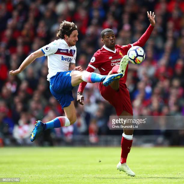 Georginio Wijnaldum of Liverpool in action with Joe Allen of Stoke City during the Premier League match between Liverpool and Stoke City at Anfield...