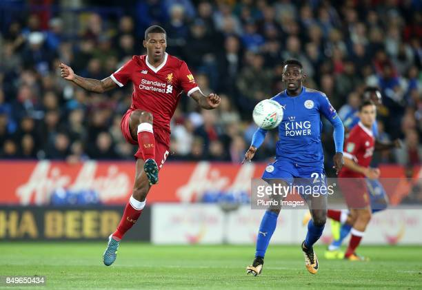 Georginio Wijnaldum of Liverpool in action with Wilfred Ndidi of Leicester City during the Carabao Cup third round match between Leicester City and...