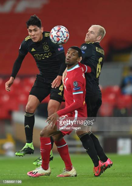 Georginio Wijnaldum of Liverpool is challenged by Edson Alvarez and Davy Klaassen of Ajax during the UEFA Champions League Group D stage match...