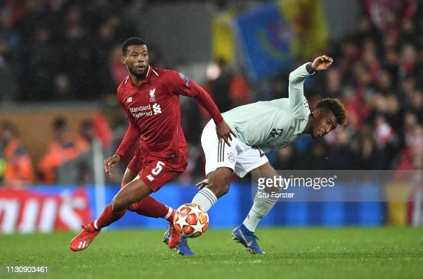 Georginio Wijnaldum of Liverpool is challenged by Kingsley Coman of Bayern during the UEFA Champions League Round of 16 First Leg match between...