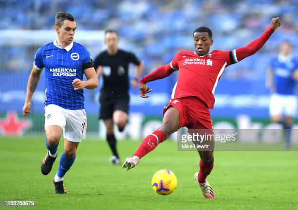Georginio Wijnaldum of Liverpool is closed down by Leondro Trossard of Brighton and Hove Albion during the Premier League match between Brighton &...