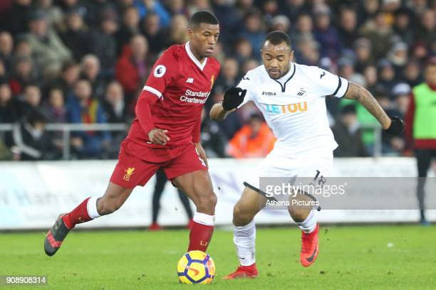 Georginio Wijnaldum of Liverpool is marked by Jordan Ayew of Swansea City during the Premier League match between Swansea City and Liverpool at the...