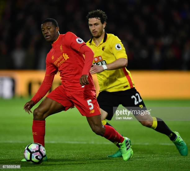 Georginio Wijnaldum of Liverpool is pursued by Daryl Janmaat of Watford during the Premier League match between Watford and Liverpool at Vicarage...