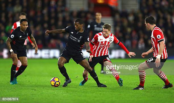Georginio Wijnaldum of Liverpool is put under pressure from Steven Davis of Southampton during the Premier League match between Southampton and...