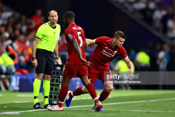 Georginio Wijnaldum of Liverpool is replaced as a substitute by teammate James Milner during the UEFA Champions League Final between Tottenham...
