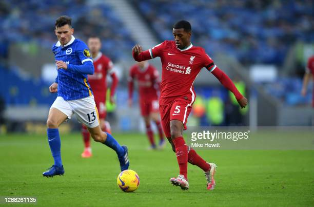 Georginio Wijnaldum of Liverpool is watched by Pascal Gross of Brighton and Hove Albion during the Premier League match between Brighton & Hove...