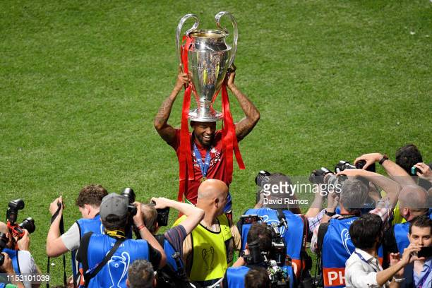 Georginio Wijnaldum of Liverpool lifts the Champions League Trophy after winning the UEFA Champions League Final between Tottenham Hotspur and...