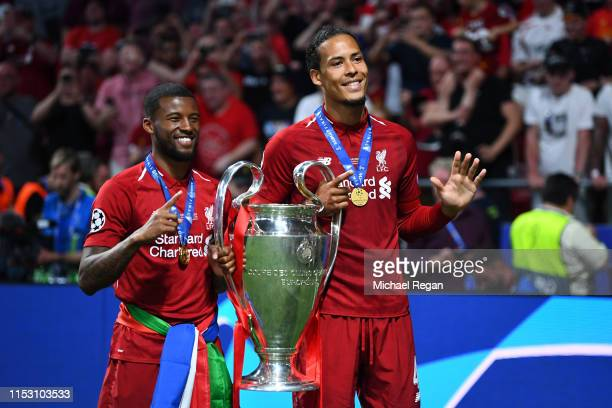 Georginio Wijnaldum of Liverpool lifts the Champions League Trophy with teammate Virgil van Dijk after winning the UEFA Champions League Final...