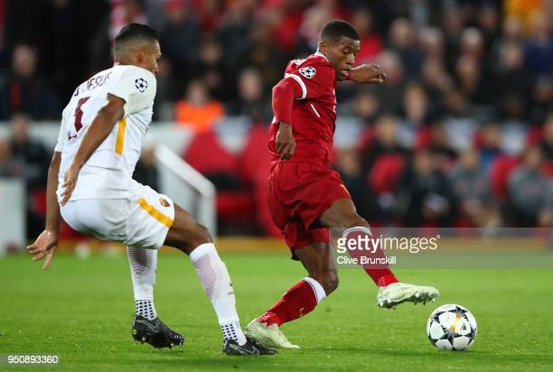 Georginio Wijnaldum of Liverpool moves away from Juan Jesus of AS Roma during the UEFA Champions League Semi Final First Leg match between Liverpool...