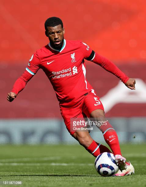 Georginio Wijnaldum of Liverpool passes the ball during the Premier League match between Liverpool and Aston Villa at Anfield on April 10, 2021 in...