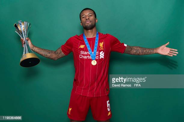 Georginio Wijnaldum of Liverpool poses with the Club World Cup trophy after the FIFA Club World Cup Qatar 2019 Final match between Liverpool and CR...