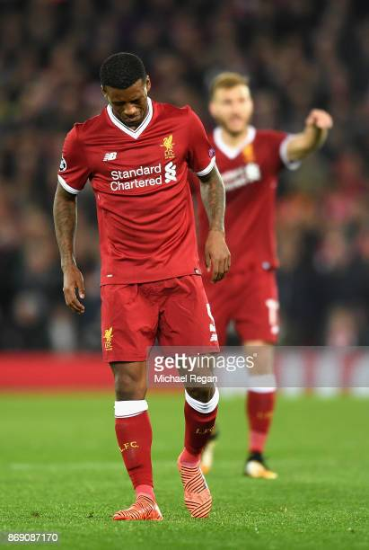 Georginio Wijnaldum of Liverpool pulls up injured during the UEFA Champions League group E match between Liverpool FC and NK Maribor at Anfield on...