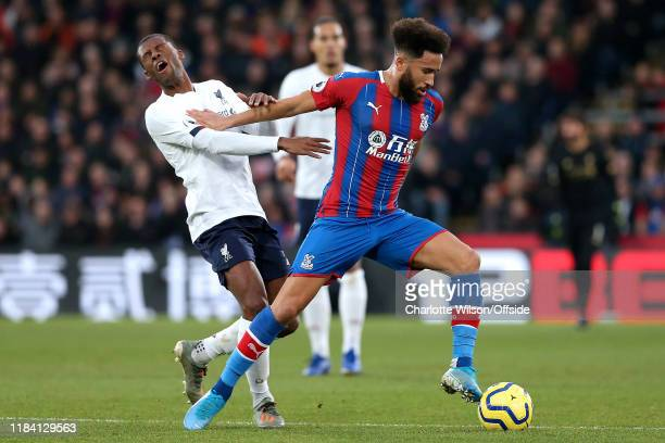 Georginio Wijnaldum of Liverpool reacts after being pushed in the face by Andros Townsend of Palace during the Premier League match between Crystal...
