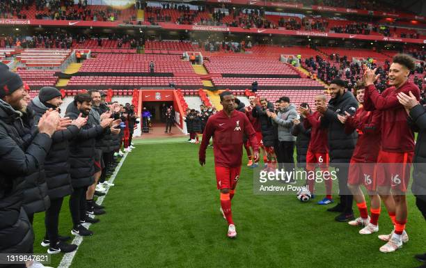 Georginio Wijnaldum of Liverpool receive his applause from the crowd and the players at the end of the Premier League match between Liverpool and...