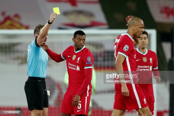 Georginio Wijnaldum of Liverpool receives a yellow card from referee Tobias Stieler during the UEFA Champions League match between Liverpool v Ajax...