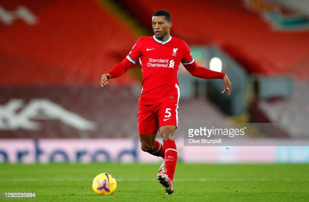 Georginio Wijnaldum of Liverpool runs with the ball during the Premier League match between Liverpool and West Bromwich Albion at Anfield on December...