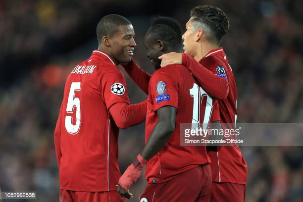 Georginio Wijnaldum of Liverpool Sadio Mane of Liverpool and Roberto Firmino of Liverpool celebrate during the Group C match of the UEFA Champions...