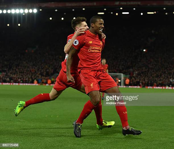 Georginio Wijnaldum of Liverpool scores and celebrates the first during the Premier League match between Liverpool and Manchester City at Anfield on...