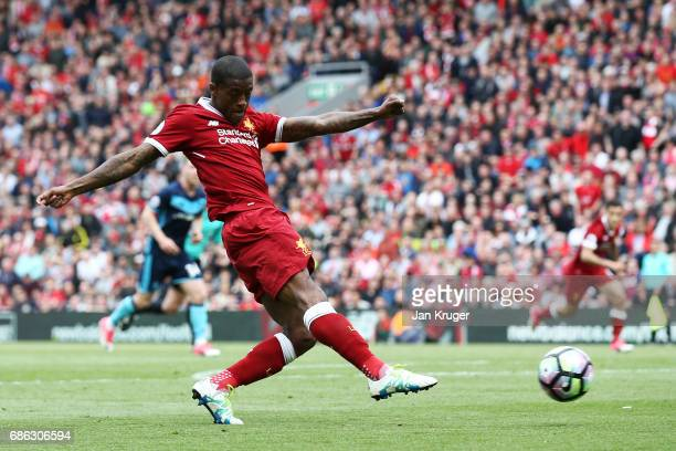 Georginio Wijnaldum of Liverpool scores his sides first goal during the Premier League match between Liverpool and Middlesbrough at Anfield on May 21...