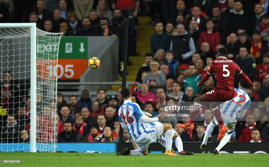 Georginio Wijnaldum of Liverpool scores his sides third goal during the Premier League match between Liverpool and Huddersfield Town at Anfield on October 28, 2017 in Liverpool, England.
