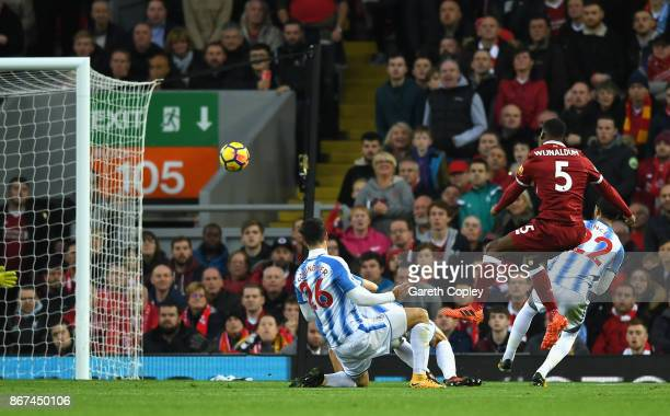 Georginio Wijnaldum of Liverpool scores his sides third goal during the Premier League match between Liverpool and Huddersfield Town at Anfield on...
